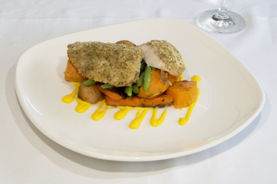 Wild Gulf Barramundi fillet topped with herb crumb, baked and served on vegetables and potatoes with saffron aioli.
